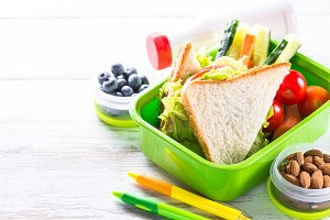 Lunch box with sandwich, vegetables
