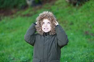 Small child in the park with a warm