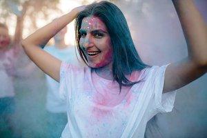 Woman enjoying festival of colors