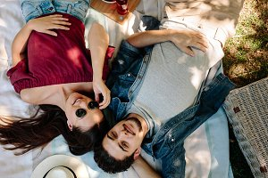 Couple in love lying on picnic