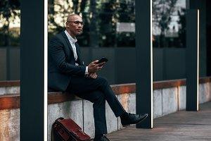 Businessman sitting outdoors