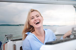 Caucasian female enjoys boat trip