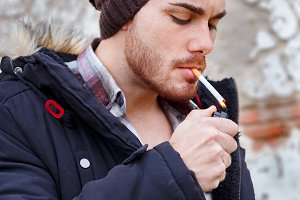 Young guy with wool cap smoking