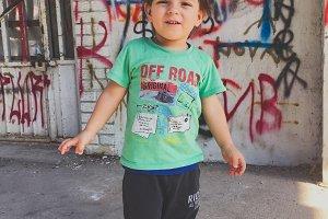 Little boy photo, graffiti wall