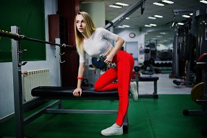 Young sport girl workout in gym. Fit