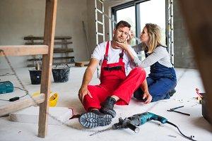 A woman helping man worker after an