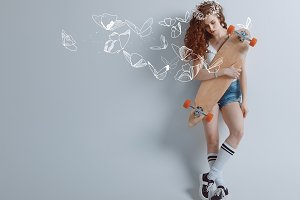redhead girl with butterflies and lo