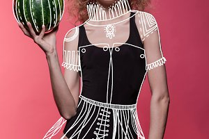 woman holding fresh watermelon