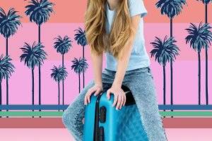 girl sitting on traveling bag