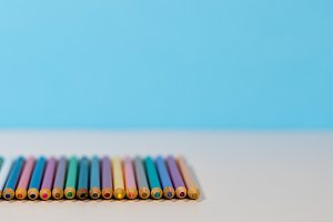 Stack of colorful pencils laid side