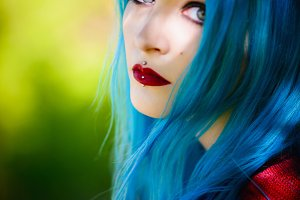 Pretty young blue-haired girl