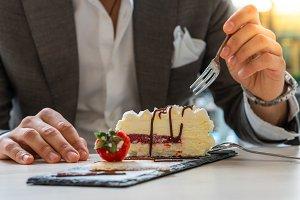 gentleman having cake