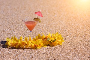 Tropical Drink and Lei on Beach Shor
