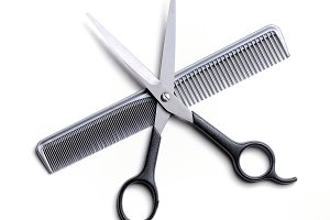 Open scissors on a comb isolated