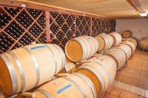 Wine Barrels and Bottles Age Inside