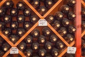Several Varietal Wine Bottles Age In