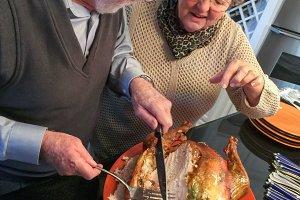 Senior Adult Couple Cutting the Holi