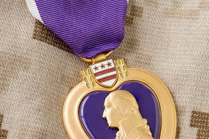 Purple Heart Medal Laying on Militar