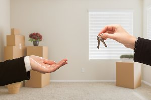 Handing Over House Keys In Room with