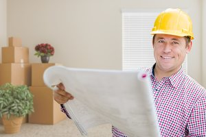 Male Construction Worker In Room Wit