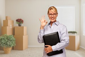 Woman with Okay Sign in Empty Room w