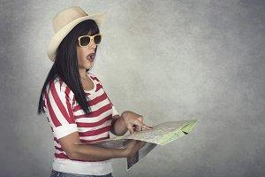 woman traveler holding map