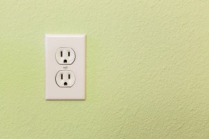 Electrical Sockets In Colorful Wall