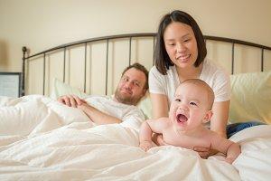 Chinese and Caucasian Baby Boy Layin