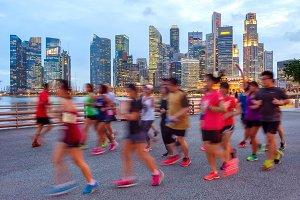 Joggers on illuminated Singapore pro