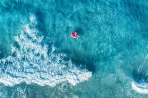 Aerial view of woman in the sea