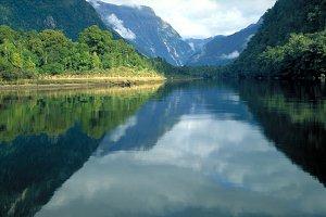 Mountains reflecting onto river