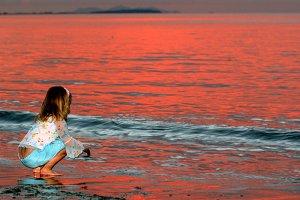Little girl playing in ocean