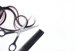 Scissors and comb with brown hair