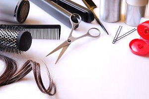 Hairdressing articles on white table