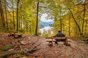 Man looking at Autumn Lake