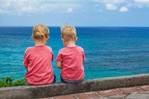 Happy kids have fun on beach walk