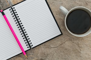 Notebook paper pencil coffee cup