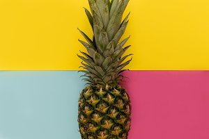 Pineapple fruit on yellow background