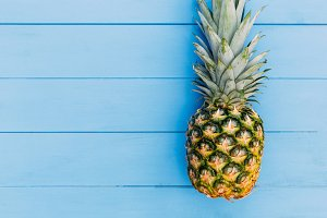 Pineapple fruit on blue background