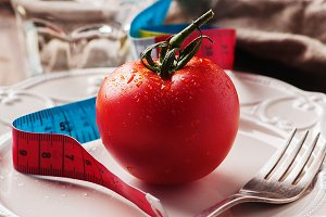 Concept of diet with red tomato
