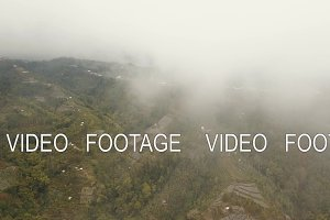 Farmland in the mountains in fog and
