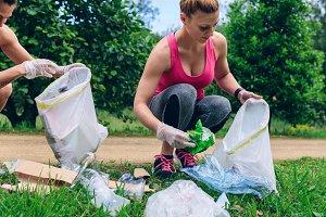 Girls with garbage bag doing ploggin