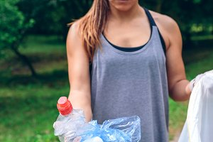 Girl showing garbage she has collect