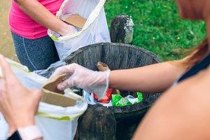 Two girls throwing garbage after plo