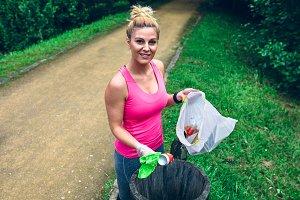 Woman throwing garbage after ploggin