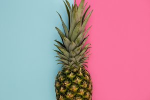 Pineapple fruit on pink background
