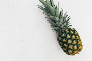 Pineapple fruit on marble background
