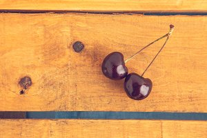 cherries on wooden background