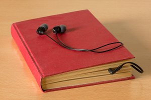 A red book with a headphones