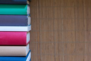 Books of various colors on a table